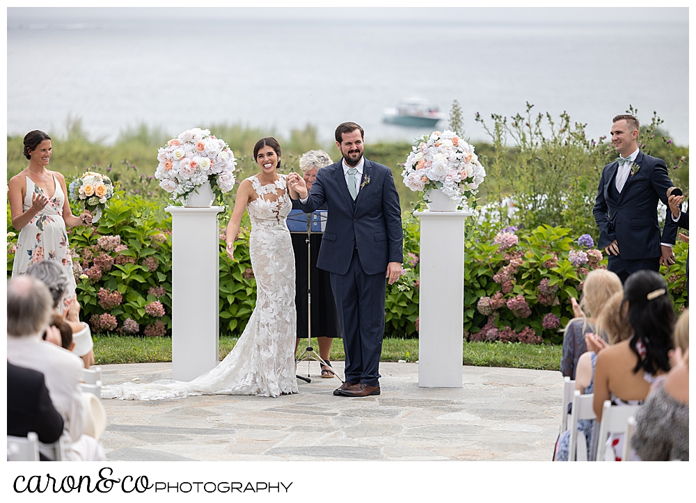 a bride and groom start their recessional during an outdoor coastal Maine wedding at the Colony Hotel, Kennebunkport Maine