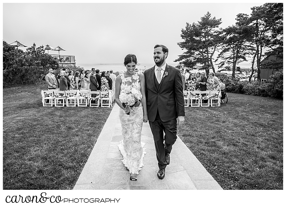 black and white photo of a bride and groom as they end their recessional at a coastal maine wedding at the colony hotel Kennebunkport maine