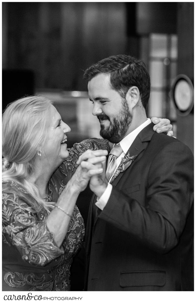 black and white photo of a groom dancing with his mother