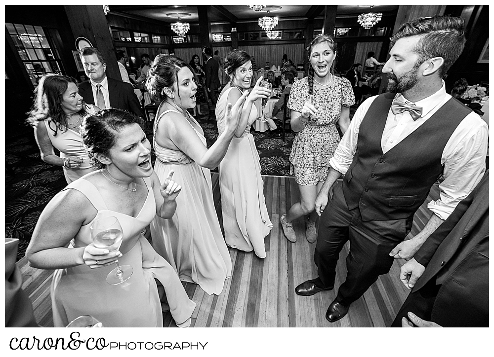 black and white photo of bridesmaids dancing at a coastal Maine wedding at the Colony Hotel Kennebunkport Maine