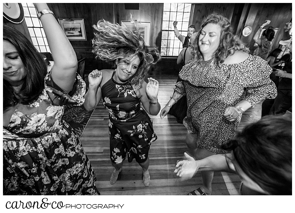 black and white photo of women dancing, one of them has her hair flying around her head