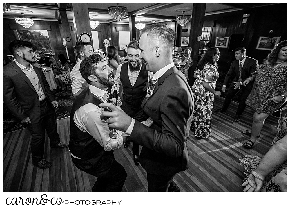 black and white photo of men dancing at a coastal Maine wedding at the Colony Hotel Kennebunkport Maine