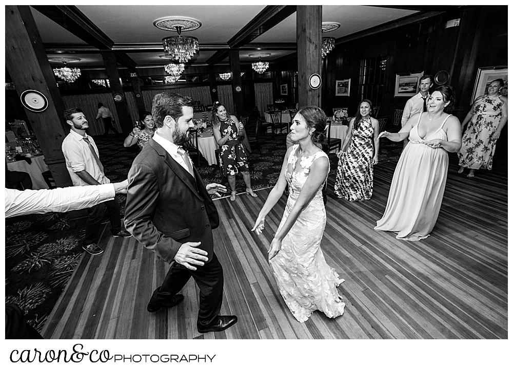 a black and white photo of a bride and groom on the dance floor at their coastal Maine wedding at the Colony Hotel Kennebunkport Maine