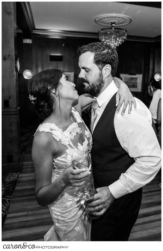 a black and white photo of a bride and groom embracing on the dance floor at their coastal Maine wedding at the Colony Hotel Kennebunkport Maine
