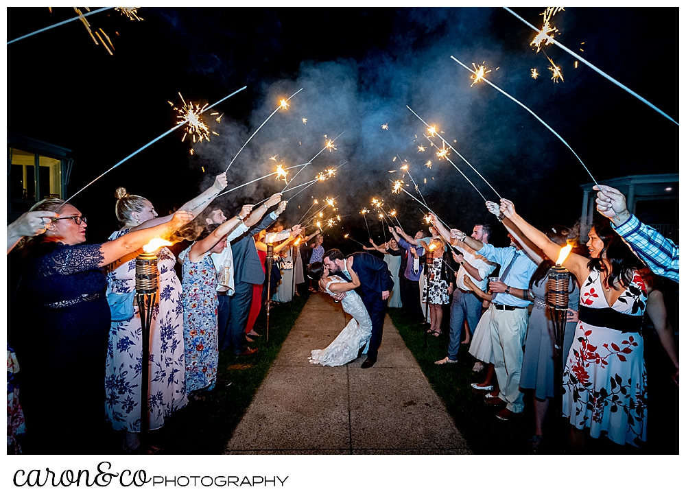 a sparkler exit with a groom dipping his bride, at a coastal Maine wedding at the Colony Hotel Kennebunkport Maine