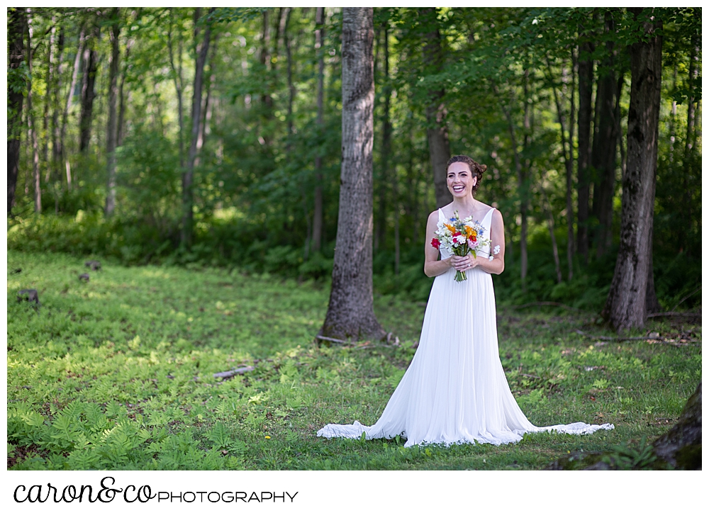 a bride smiles during her Maine wedding day first look