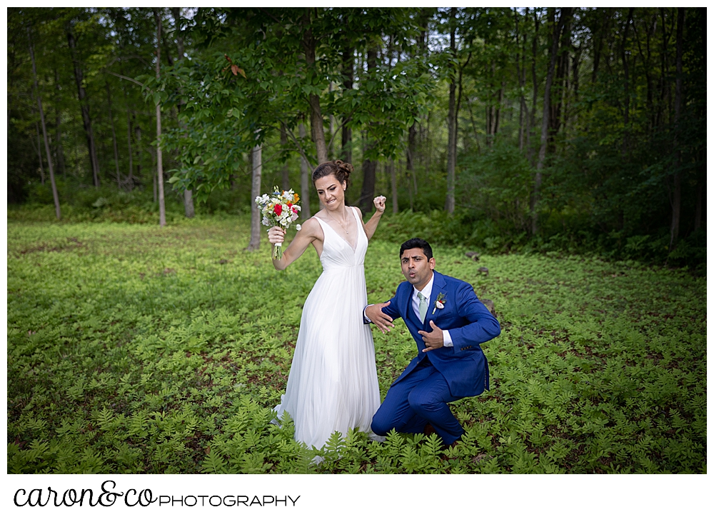 a bride and groom dance in the woods