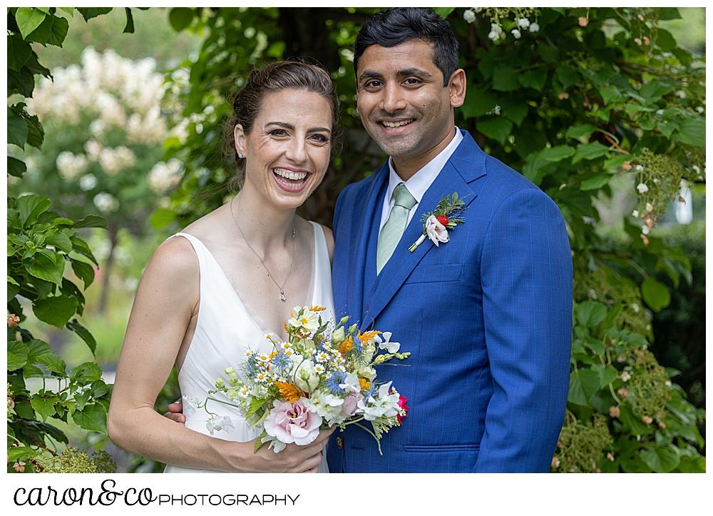 bride and groom couples portrait at a joyful Pineland farms wedding