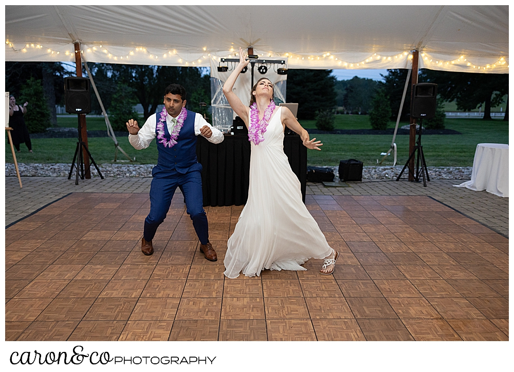 bride and groom doing a choreographed first dance, the bride's head is thrown back