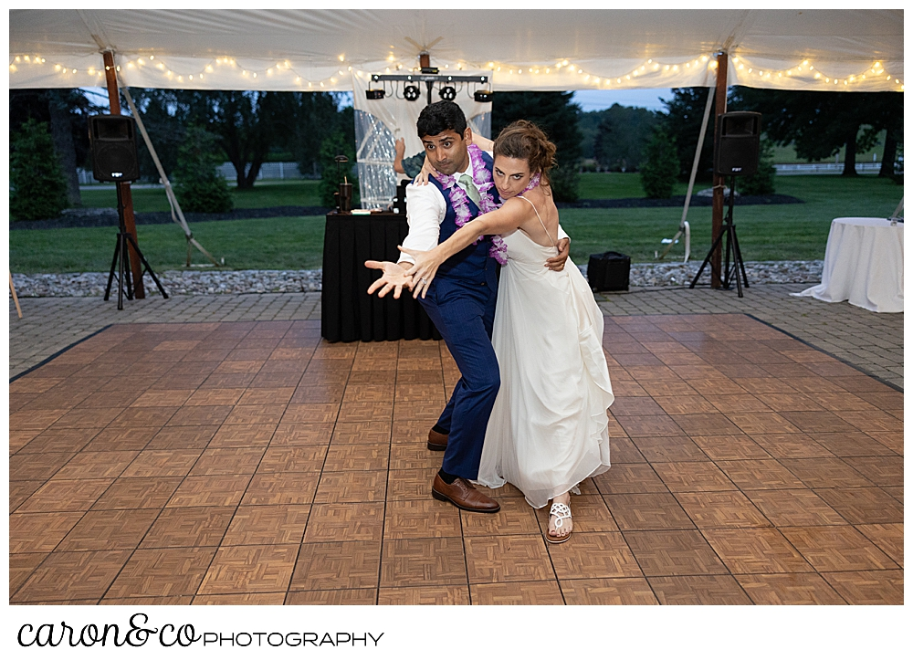a bride and groom dance during the first dance in a tango pose