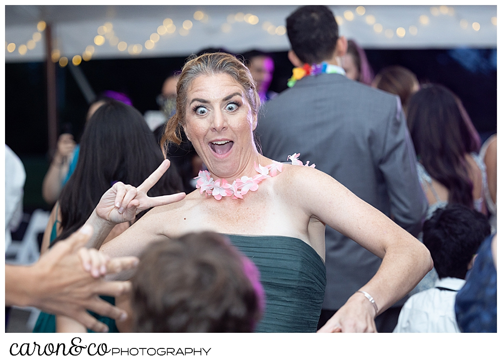 a bridesmaid dancing and having fun